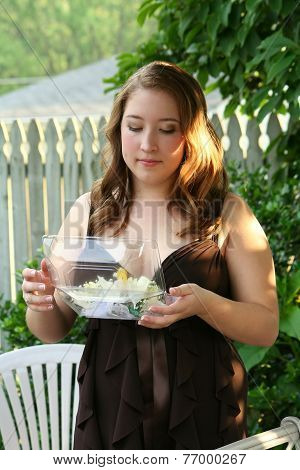 Prom Girl Looking At Corsage