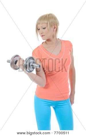 Young Beautiful Athlete With A Dumbbell.