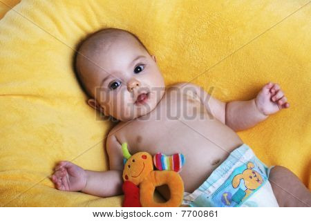 Baby on a yellow planket