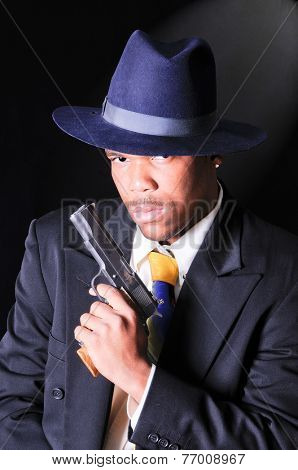 smartly dressed African American man, either a retro gangster or FBI agent theme