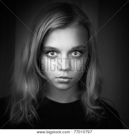 Serious Blond Caucasian Girl With Mysterious Look