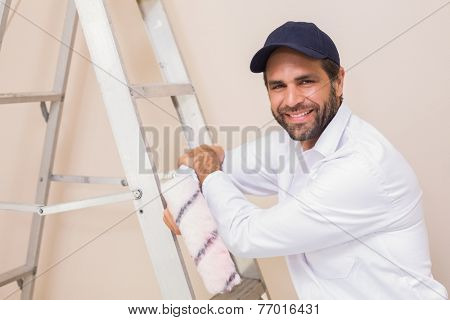 Painter smiling at the camera in a new house poster