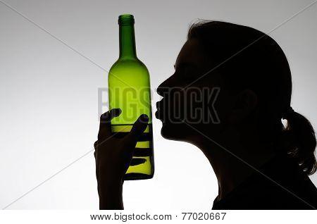 Alcoholic Woman Kissing A Wine Bottle