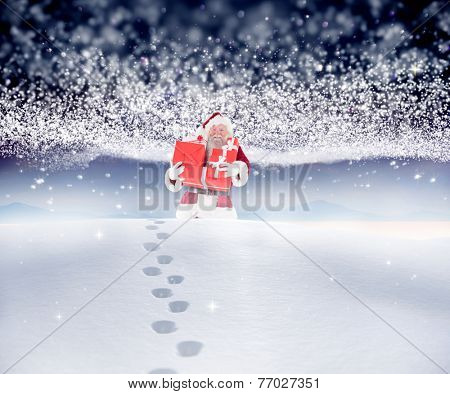 Santa carrying gifts in the snow against bright stars of energy over landscape poster