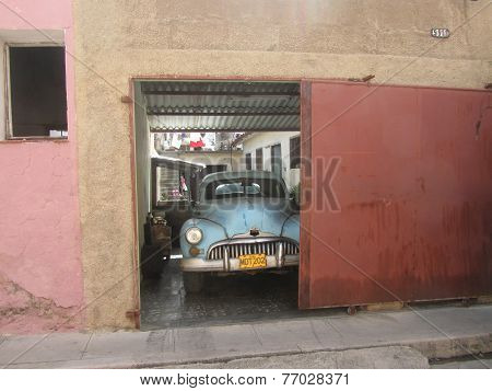 Old-fashioned Cuban Car In A Garage In Matanzas, Cuba. I Like The Colour Of This Image, The Red Of T