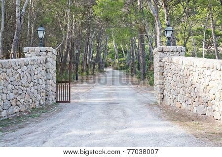 Dry stone gates by luxurious estate