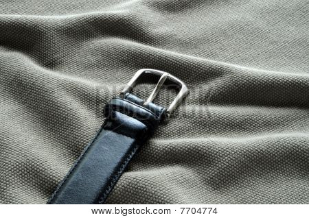 Black leather belt with silvery buckle