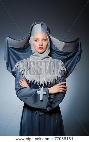 Young nun in religious concept poster