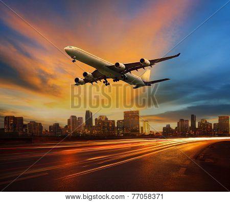 Beautiful Lighting Of Vehicle In Land Transportation And Passenger Jet Plane Flying Above Urban Scen