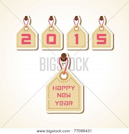 creative New Year 2015 design with hanging label concept stock vector