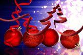 Ribbon in shape of christmas tree against light design shimmering on purple poster