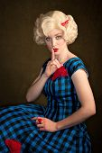 Pretty retro blonde woman in vintage 50s dress poster