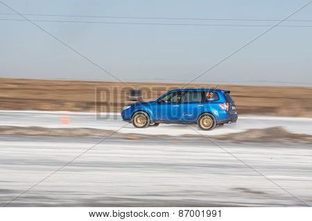 Blue subaru Forester on ice track