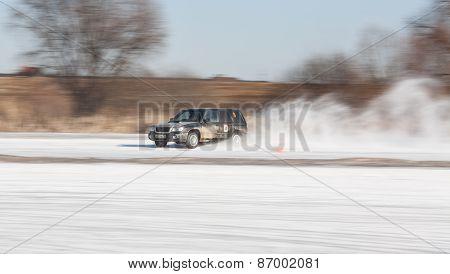Black subaru Forester on ice track