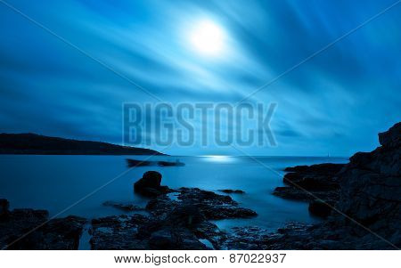 Blue seascape by night
