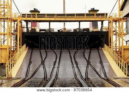 Big industrial Ro-Ro ship is loading. Railway ramp Varna rail ferry complex Bulgaria poster