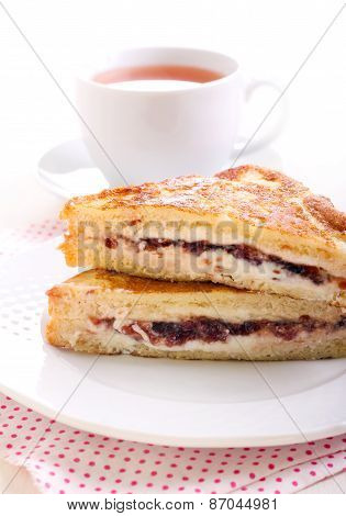 Eggy bread or French toast with cheese and jam filling poster
