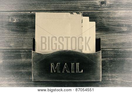 Vintage Style Old Metal Mailbox On Weathered Wood