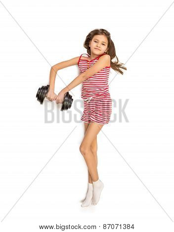 Isolated Photo Of Little Girl Lying On Floor And Lifting Dumbbell