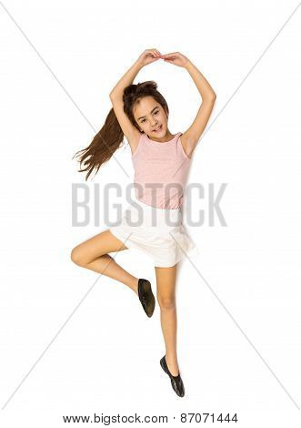 High Point View Of Cute Girl Lying On Floor And Pretending To Dance Ballet
