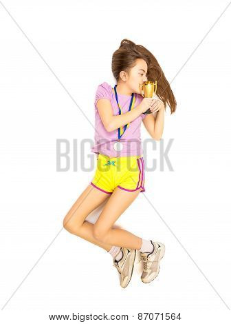 Isolated Shot Of Happy Girl Lying On Floor And Kissing Trophy Cup