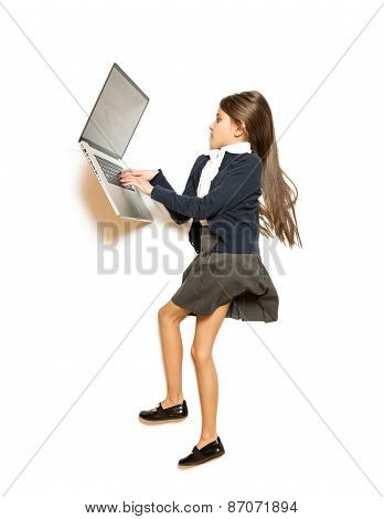 Isolated Shot Of Cute Girl Lying On Floor And Using Laptop