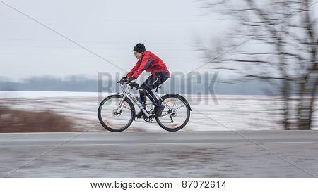 Woman riding her bike. Panning