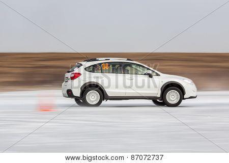 White subaru Impreza XV on ice track