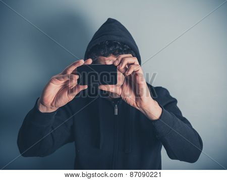 Man In Hooded Top Taking Photos