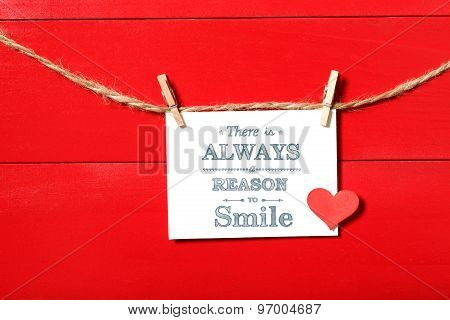There is always a reason to smile message card hanging with clothespins poster