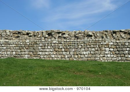 Stone Wall, Grass And Sky