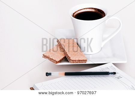 Cup Of Tea With Notebook