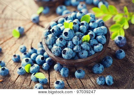 Blueberry on wooden table background. Ripe and juicy fresh picked blueberries closeup. Berries closeup