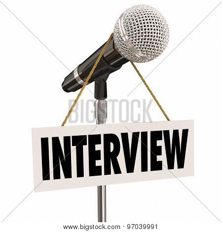 Interview word on hanging sign on microphone to illustrate questions and answers for a speaker or panel discussion