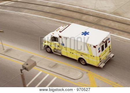 Panning Ambulance Paramedic Racing Down The Road