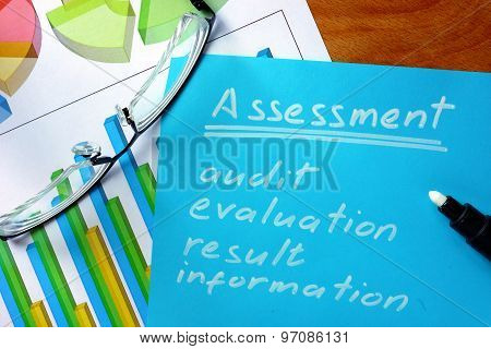 Blue paper with word  assessment.