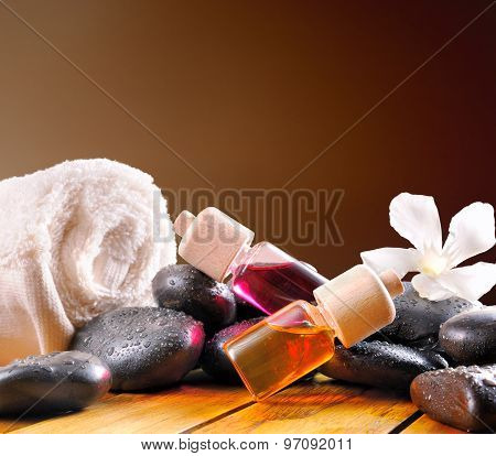 Oil Containers Stones And Towel Square Composition