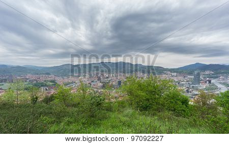 Wide angle view of Bilbao skyline from Artxanda mountain, stormy day poster