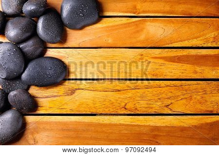 Stones With Drops In The Top Left Corner On Wooden