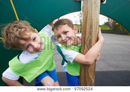 Boys On Climbing Wall In School Physical Education Class