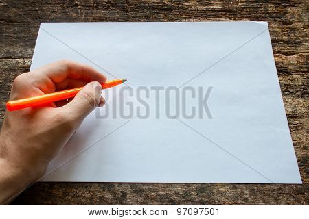 Lefty Writes With A Ballpoint Pen On A Sheet Of Paper On Wooden Table International Lefthanders Day