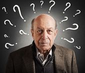 Old man confused with many question marks poster