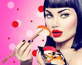 Beauty Fashion model girl eating Nigiri Sushi with chopsticks. Beautiful sexy woman with perfect make up and bob haircut eating healthy japanese food. Diet, dieting concept.  poster