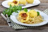 """Handmade potato dumplings stuffed with greaves served on warm cabbage salad, an Austrian and Bavarian specialty (so-called """"Grammelknodel"""") poster"""