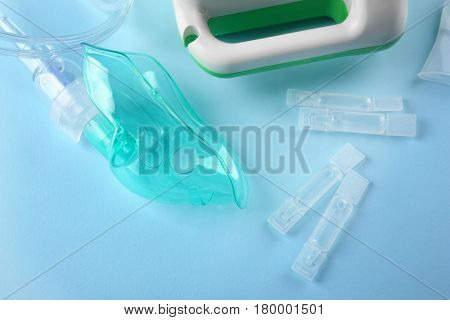 Ampoules with remedy for inhalation therapy on color background