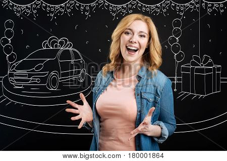 Cant believe. Overjoyed delighted woman expressing gladness after winning the car in a lottery