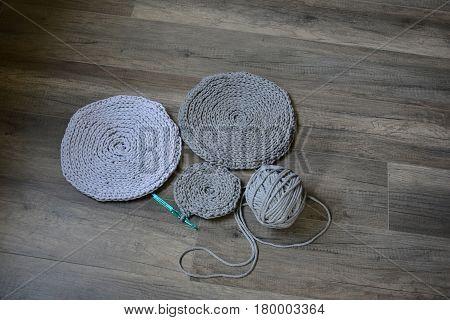 grey handmade cotton cord tablecloths on crochet hook