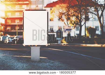 Empty mock up banner on paving stone for your advertising blank billboard with copy space area for your text message or promotional content public information board on pavement near road with cars