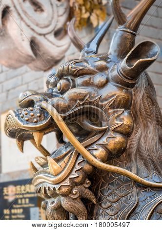 Tianjin, China - Nov 1, 2016: Closeup of the head of a Qilin (Kirin) along the famous Tianjin Ancient Cultural Street. Qilin is a mythical animal in Chinese folklore.