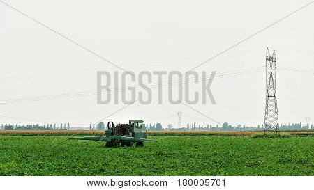 Tractor With Plough Doing Some Seasonal Agricultural Work In Field